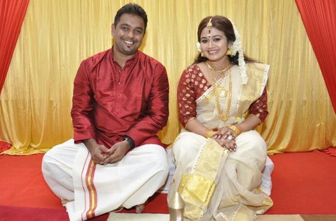 Sharanya Sasi with Her Hasband Binu Xavier at her engagement